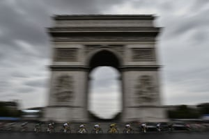 Chris Froome, in the leader's yellow jersey, rides past the Arc de Triomphe during the final stage of the Tour de France.