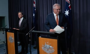 Prime Minister Scott Morrison at an evening press conference with health minister Greg Hunt announcing new recommendations for the administration of the AstraZeneca vaccine.
