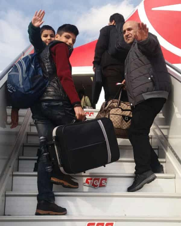The Batous family board the aeroplane from Turkey to Britain.