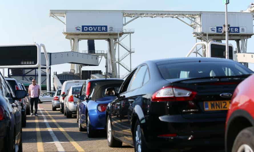 Cars queue to board a ferry in Dover bound for Dunkirk, France