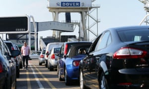 Cars queue to board a ferry in Dover bound for Dunkirk, France.