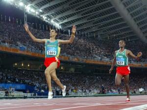 Hicham El Guerrouj beats Kenenisa Bekele to win the 5,000m at the Athens Olympics.