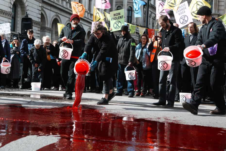 Fake blood is poured near Downing Street