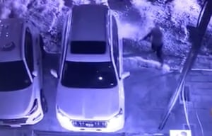 Man approaches car