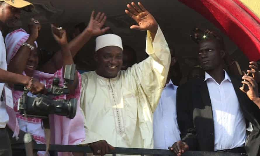 The Gambia's president-elect, Adama Barrow (centre), greets the crowds after his election victory.