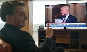President Jair Bolsonaro gestures during a video of himself watching Donald Trump during his rambling post-impeachment speech.