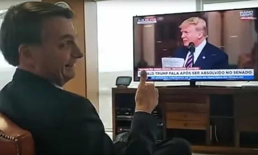 President Jair Bolsonaro gestures during a video of himself watching Donald Trump during his rambling post-impeachment speech.