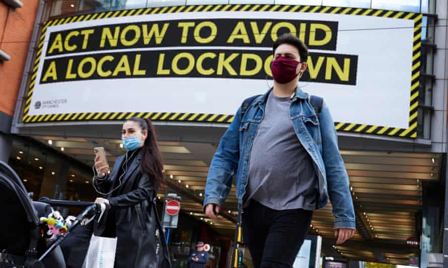 A coronavirus warning is displayed to shoppers in Manchester, where rates of infection are about 10 times higher than in Bristol.