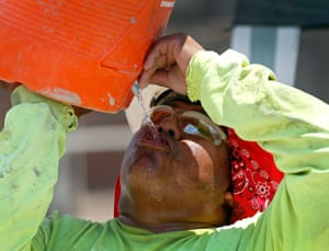 A Phoenix-area construction worker drinks water at a job site on 20 June