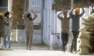 Suspected Sikh militants surrender after the Indian government's 1984 assault on the Golden Temple.