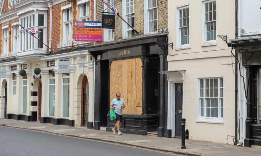 Man walks past boarded up Jack Wills shop