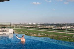 The rooftop pool at Meydan Hotel. In the background is Meydan racecourse, a horse racing facility that can accommodate over 60,000 spectators in a mile-long grandstand.