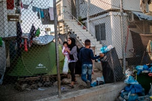 A woman and child at Moria refugee camp in Lesbos, Greece
