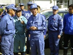 Shinzo Abe visits an area devastated by Typhoon Hagibis in Koriyama, Japan
