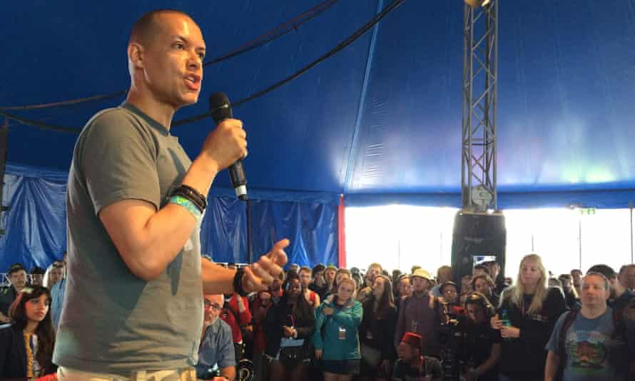 Clive Lewis MP, holding microphone, at a Leftfield event