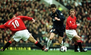 Michael Carrick of West Ham beats Teddy Sheringham of Manchester United.