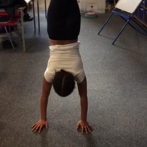 Sofia, eight doing gymnastics