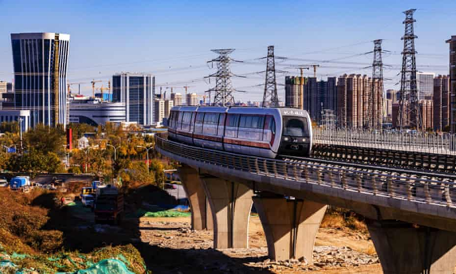 A maglev train runs on Beijing's S1 line during a trial operation.