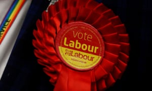 Britain's general election 2019<br>A Labour Party rosette is seen on a jacket as ballots are tallied at a counting centre for Britain's general election in Wakefield, Britain, December 13, 2019.  REUTERS/Andrew Boyers