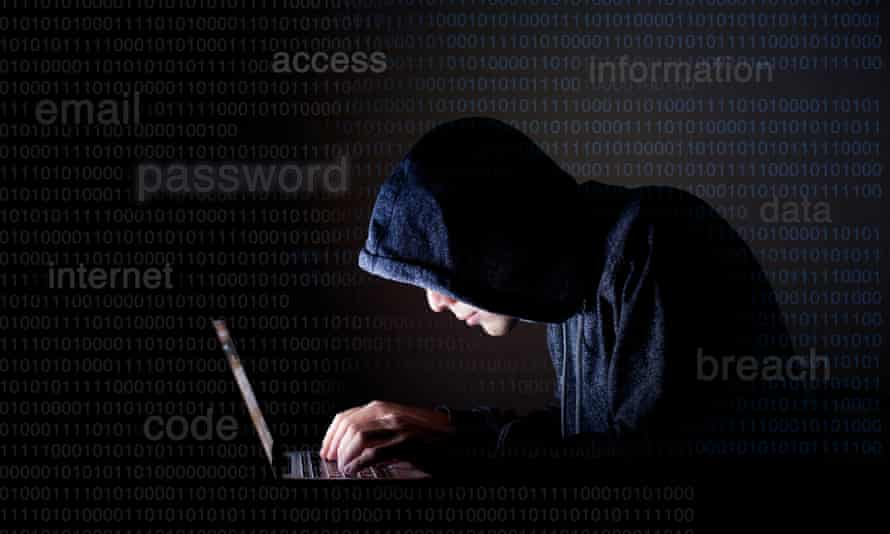 A computer hacker (posed by model).