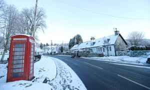 Snow sits on a red telephone box after snowfall in Moulin, Scotland