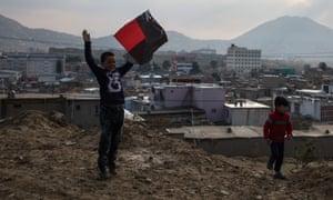 Boys take to the hills surrounding Kabul, where they fly their kites