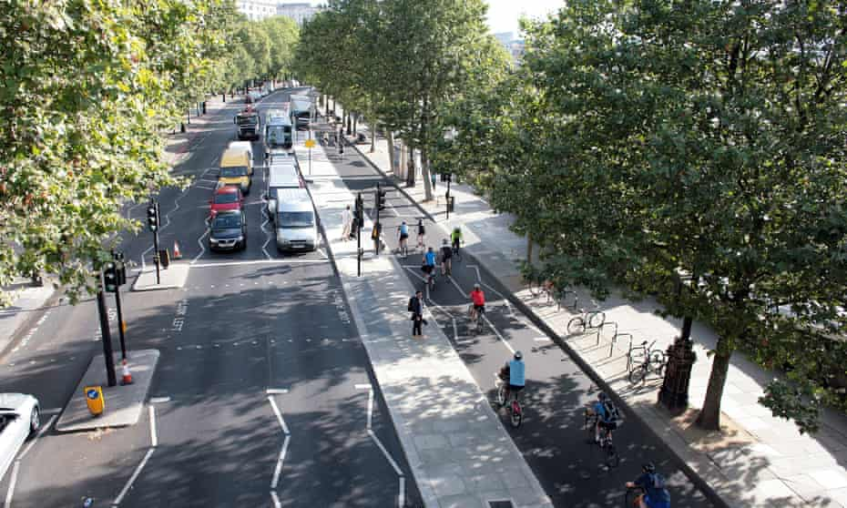 Cyclists make the morning commute along the Victoria Embankment stretch of London's east-west cycle superhighway.