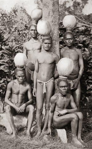 This 19th century photograph shows an initiation. Four or five youths were chosen and taken into a hut to do various forms of labour, learn the tribal rules and had to always wear these traditional hats. When their hair filled the hat the period of seclusion was over.