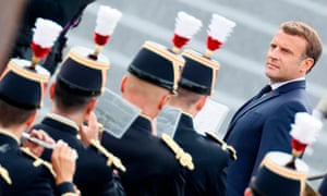 French President Emmanuel Macron reviews the guard of honour during the annual Bastille Day military ceremony