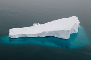 The slab sides and sharp angles of the portion above the surface belie the bulk and reach of the ice below the water