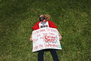 Gail Norman participates in a die-in protest on 22 May in Miami Beach, Florida, asking the state to fix its unemployment system.