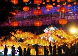 Hong Kong, China: Visitors admire lanterns and installations at Victoria Park on the eve of a mid-autumn festival