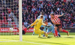 Will Grigg fires home Sunderland's third goal of a 5-4 loss.