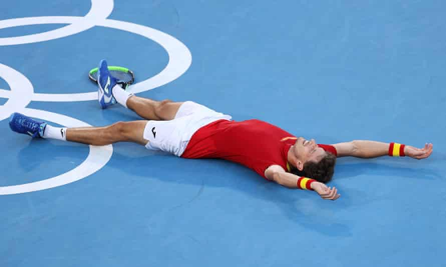 Pablo Carreño Busta collapses in triumph after sealing the bronze medal.