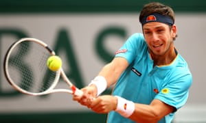 Cameron Norrie plays a backhand against Lucas Pouille.