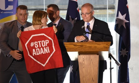 An anti-Adani protester disrupts the PM's speech. Scott Morrison and Josh Frydenberg are playing down the remaining approvals for the coalmine.