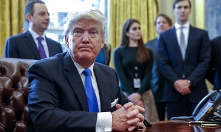 White House aides including Hope Hicks, center, stand behind Donald Trump at the signing of executive orders this week.