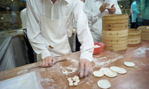 File photo of workers in the kitchen of a Din Tai Fung restaurant