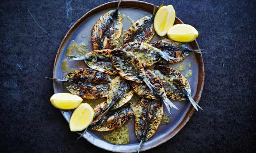Barbecued sardines with parsley, roast garlic and lemon butter. Photograph: David Loftus