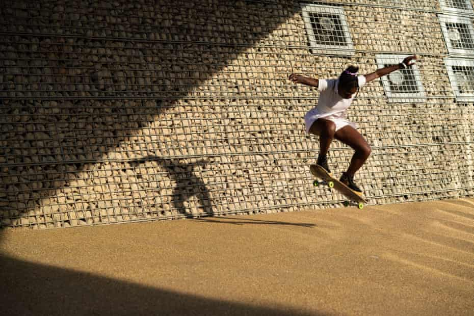 Maz Mayassi, the co-founder of Melanin Skate Gals and Pals, ollies under a bridge in East London. She works to bring more people of colour into skateboarding through events and awareness driving activities.
