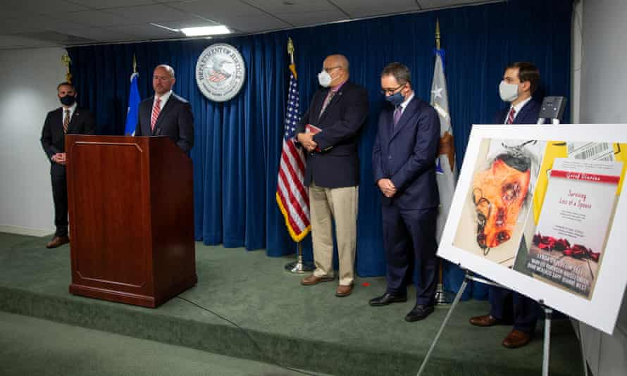 Massachusetts district attorney Andrew Lelling, second from left, announces charges against six former eBay senior employees.