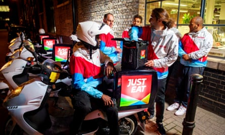 Just Eat drivers prepare to deliver food