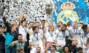 Real Madrid lift the Champions League trophy.