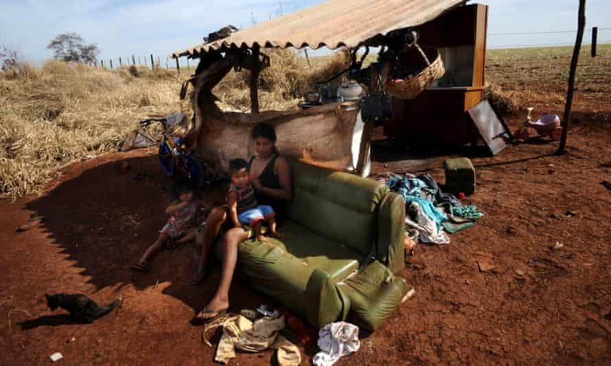 Dilcia Lopes and her children live in a makeshift camp squeezed between highway BR 463 and their ancestral land called Tekoha Apika'y, where they have been since 2009 after failing to take back the land from farmers, near Dourados, Mato Grosso do Sul state.