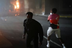 A man films a burning Wendy's following a rally against racial inequality and the police shooting death of Rayshard Brooks, in Atlanta.