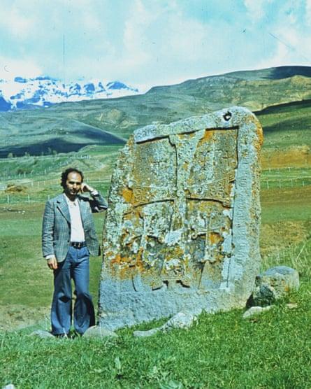 Armenian art researcher Argam Ayvazyan in 1981, next to a 14th-century khachkar in Nors, near his birthplace.
