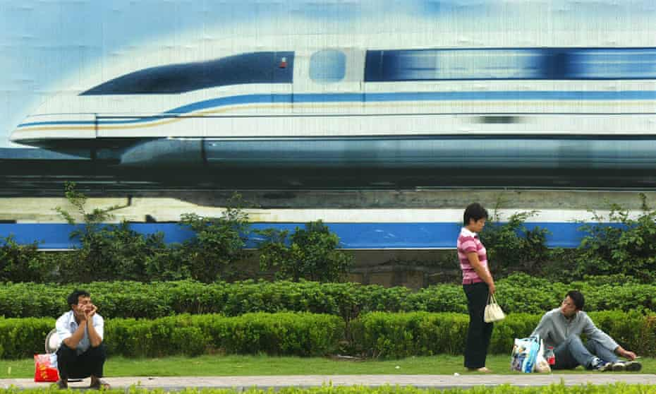A vision of high-speed growth … a billboard features a magnetic levitation train in Shanghai.