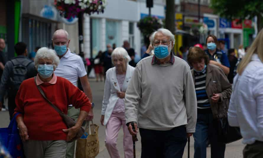 Shoppers, most wearing face masks