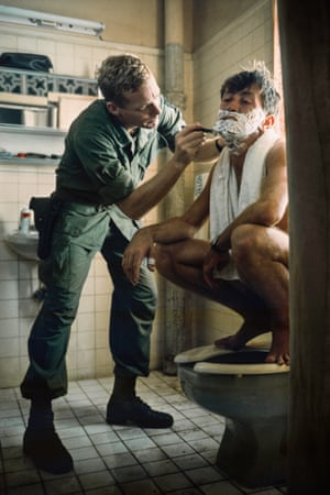 Martin Sheen receives a wet shave atop a toilet. The actor, then 36, suffered a breakdown and near-fatal heart attack during the shoot, which overran by around seven months.