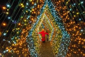 Two children walk through a tunnel of lights in Stockbridge, Massachusetts